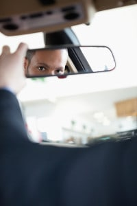 bigstock-Man-adjusting-a-rear-view-mirr-34979918