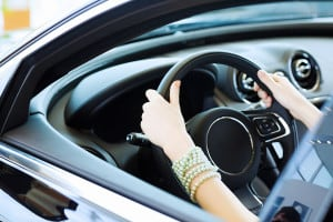 bigstock-Close-up-of-woman-hands-drivin-50089532