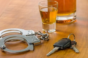 bigstock-Shot-glass-with-car-keys-and-h-47497273